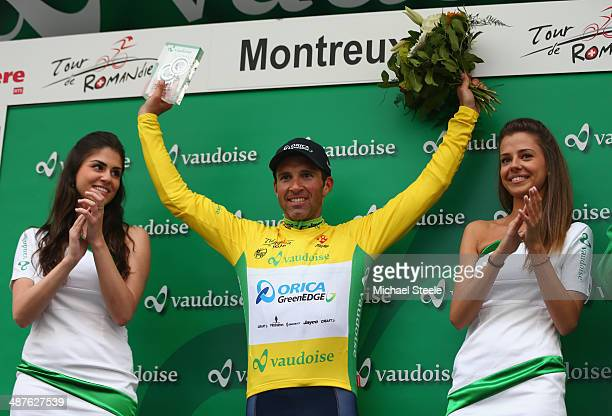 Michael Albasini of Switzerland and Orica GreenEdge receives the crowds applause on the podium after victory during stage two and claiming the yellow...