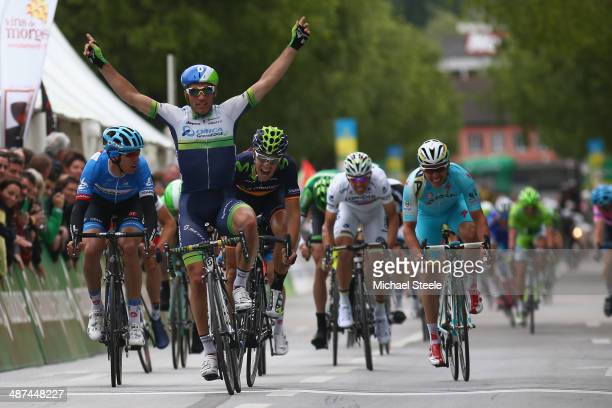 Michael Albasini of Switzerland and OricaGreenEdge celebrates victory in a sprint finish during stage one of the Tour de Romandie from Ascona to Sion...