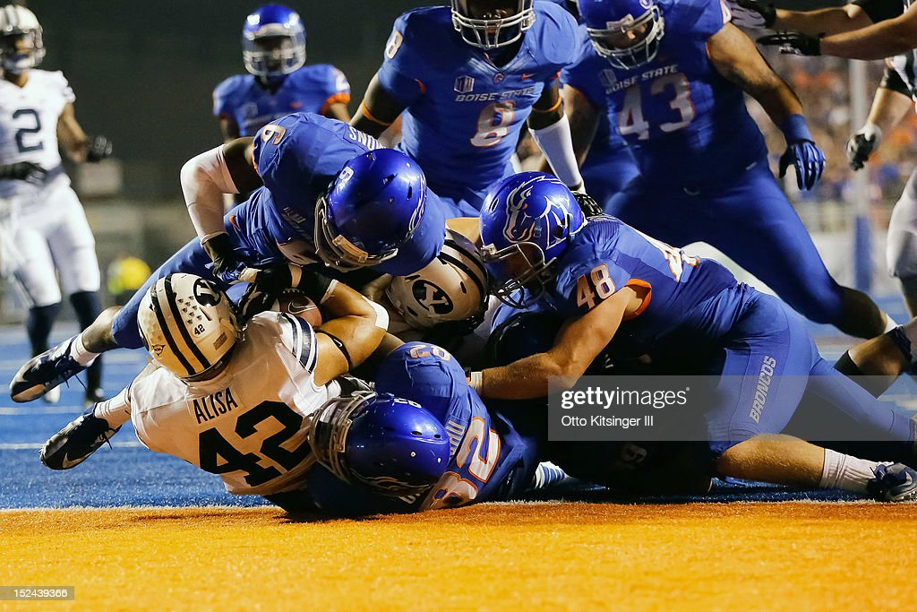 Michael Alisa #42 of the BYU Cougars is brought down by the Boise State Broncos on the Broncos 1 yard line at Bronco Stadium on September 20, 2012 in Boise, Idaho.