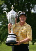 Michael Allen holds the Alfred S Bourne trophy after winning the 70th Senior PGA Championship at Canterbury Golf Club on May 24 2009 in Beachwood Ohio
