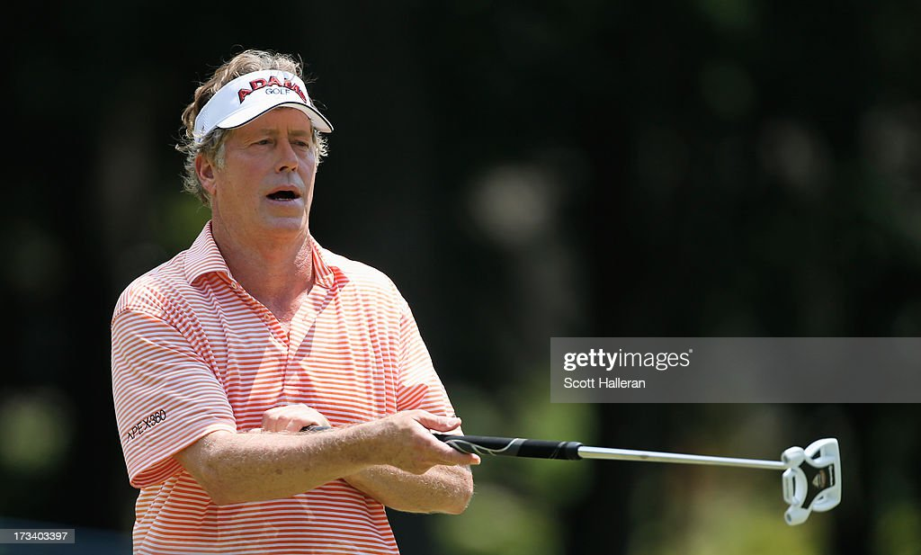 Michael Allen reacts to a putt on the fifth green during the third round of the 2013 U.S. Senior Open Championship at Omaha Country Club on July 13, 2013 in Omaha, Nebraska.