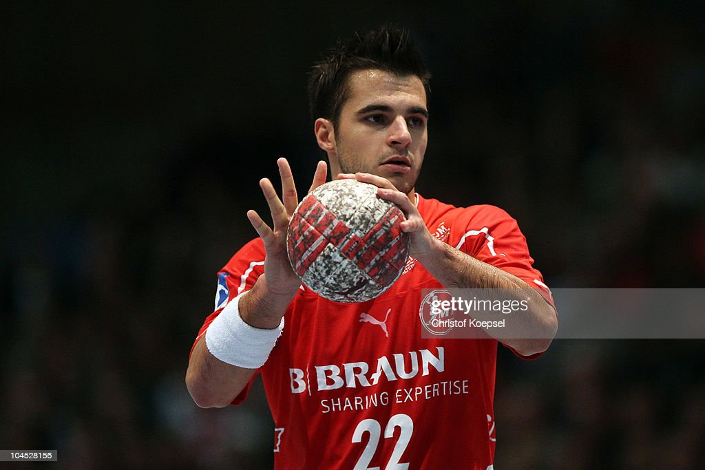 Michael Allendorf of Melsungen passes the ball during the Toyota Handball Bundesliga match between MT Melsungen and THW Kiel at the Rotehnbach Hall on September 28, 2010 in Kassel, Germany.