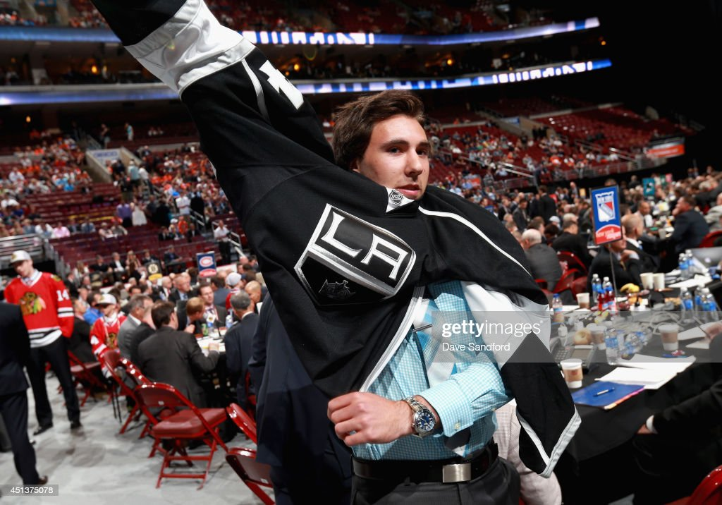 Michael Amadio puts on his jersey after being selected 90th overall by the Los Angeles Kings during the 2014 NHL Entry Draft at Wells Fargo Center on June 28, 2014 in Philadelphia, Pennsylvania.