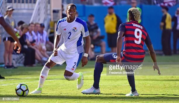 Michael Amir Murillow of Panama carries the ball past Gyasi Zardes of USA during the second half of a CONCACAF Gold Cup Soccer match at Nissan...