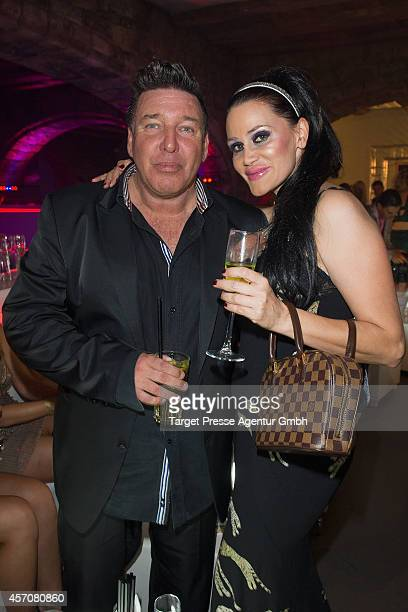 Michael Ammer and Djamila Rowe attend the Adagio ReOpening on October 11 2014 in Berlin Germany