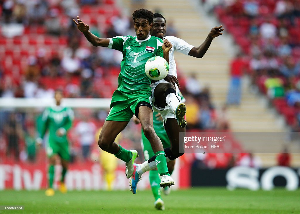 Michael Anaba (R) of Ghana and Jawad Kadhim of Iraq compete for the ball during the FIFA U-20 World Cup 3rd Place playoff match between Ghana and Iraq at Ali Sami Yen Arena on July 13, 2013 in Istanbul, Turkey.