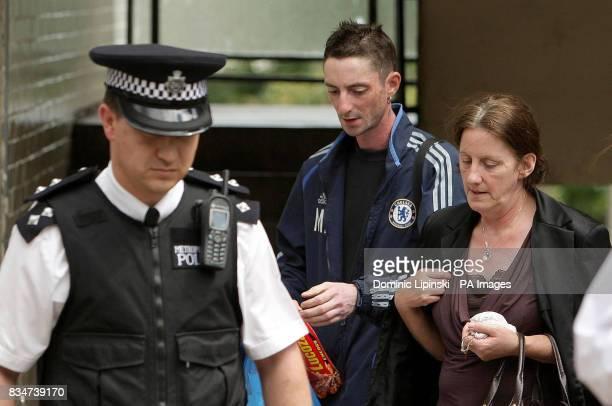 Michael and Anne Burke the brother and mother of murdered teenager Cara Burke leave the family home in Southfields South West London