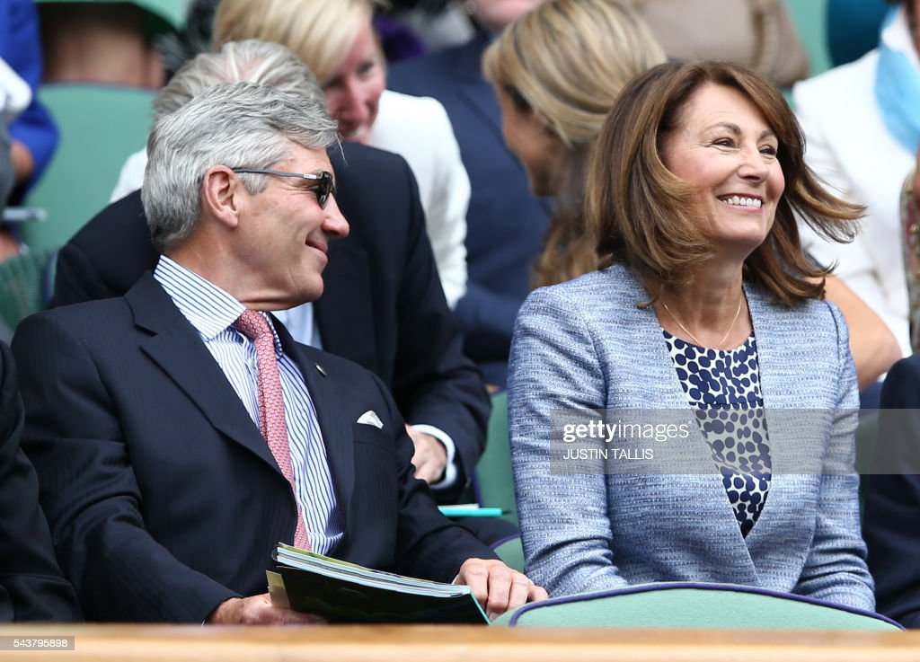 Michael (L) and Carole Middleton sit in the Royal box on centre court watching Japan's Kei Nishikori and France's Julien Benneteau during their men's singles second round match on the fourth day of the 2016 Wimbledon Championships at The All England Lawn Tennis Club in Wimbledon, southwest London, on June 30, 2016. / AFP / JUSTIN