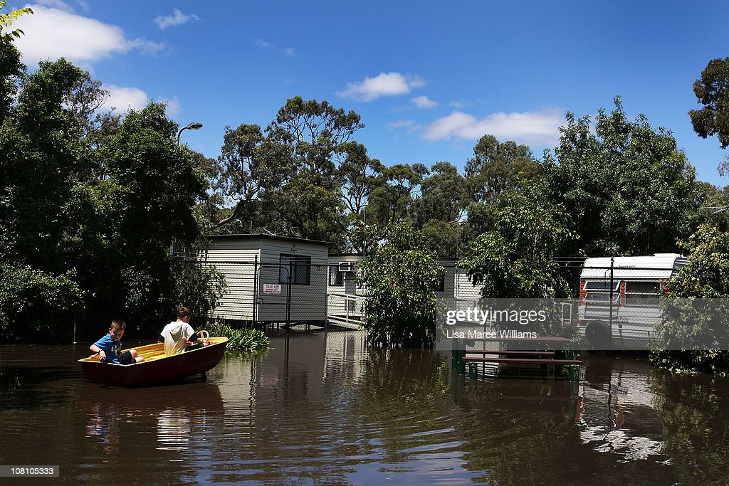 Michael and Noah Collins-Clarke sit in a toy boat in a flooded public park on January 18, 2011 in Horsham, Australia. Residents and emergency crews sandbagged properties and evacuations have been ordered in the town experiencing the worst flooding in over 200 years. A relief centre has been set-up in at Horsham Town Hall and emergency crews are on-site as the Wimmera River water level reaches it's peak. The Victorian floods have so far claimed one life, with the body of a missing seven-year-old boy believed to be found earlier today.
