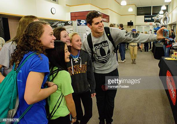 Michael Andrew takes a selfie with fans after the finals at the Arena Pro Swim Series on November 14 2015 at Jean K Freeman Aquatics Center in...