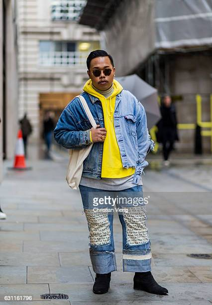 Michael Angelo wearing a yellow hoody denim jacket denim jeans during London Fashion Week Men's January 2017 collections at Lou Dalton on January 7...