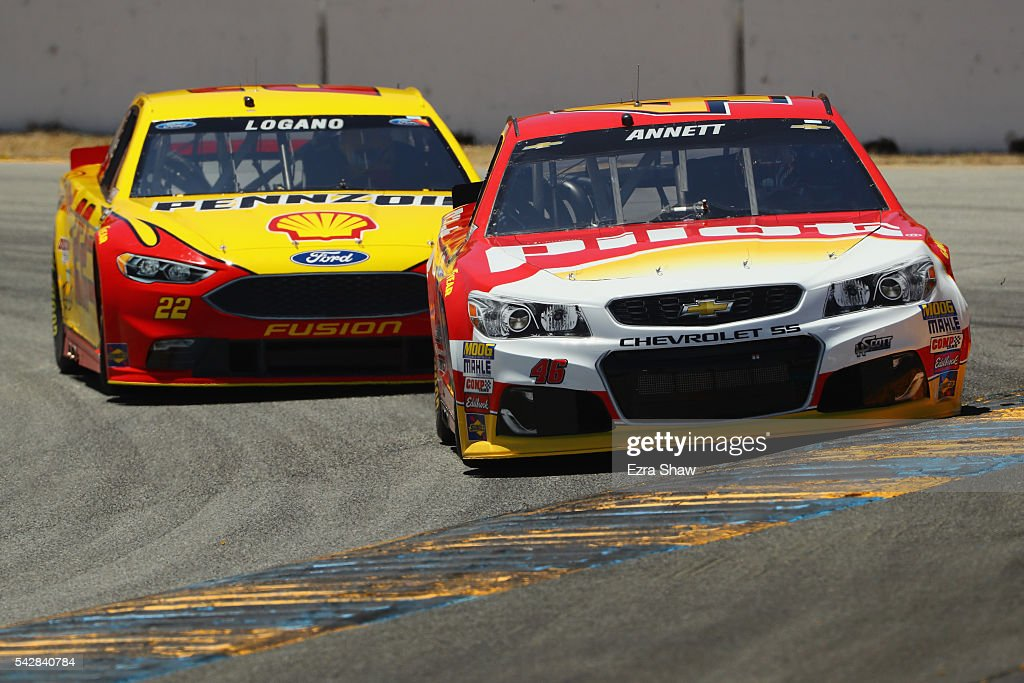 Michael Annett, driver of the #46 Pilot Flying J Chevrolet, leads Joey Logano, driver of the #22 Shell Pennzoil Ford, during practice for the NASCAR Sprint Cup Series Toyota/Save Mart 350 at Sonoma Raceway on June 24, 2016 in Sonoma, California.