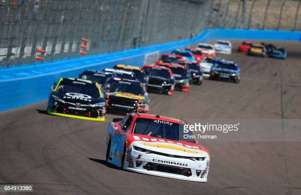 Michael Annett driver of the Pilot Flying J Chevrolet races during the NASCAR XFINITY Series DC Solar 200 at Phoenix International Raceway on March...