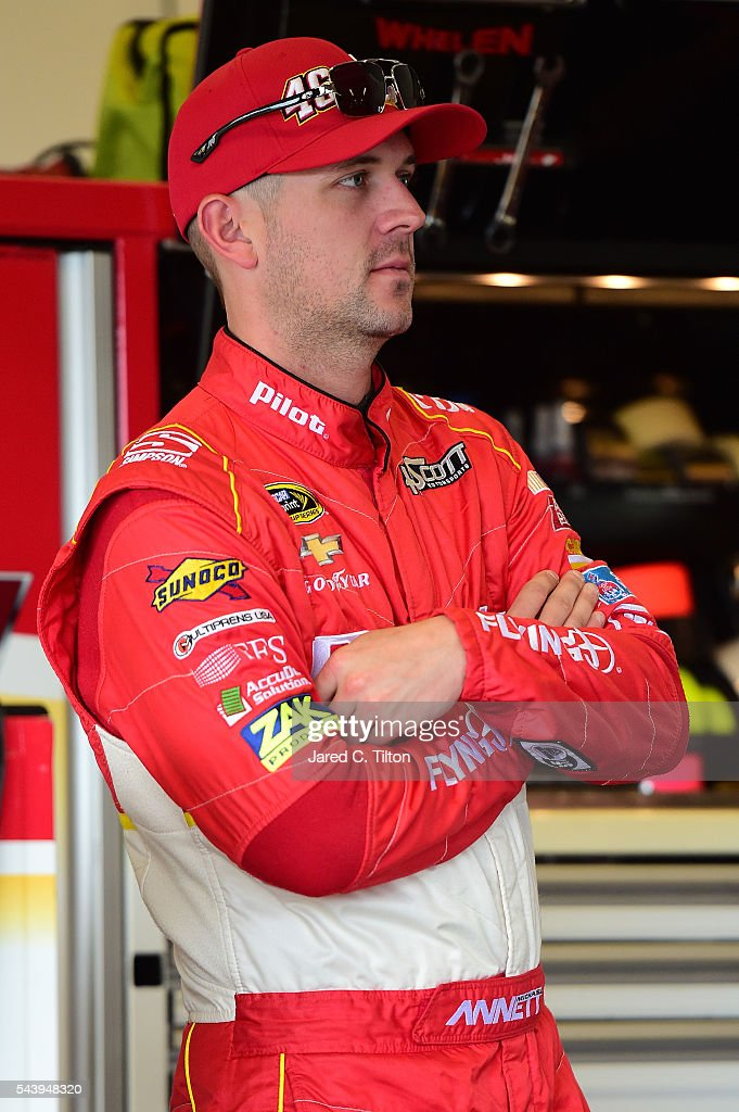 <a gi-track='captionPersonalityLinkClicked' href=/galleries/search?phrase=Michael+Annett&family=editorial&specificpeople=4531973 ng-click='$event.stopPropagation()'>Michael Annett</a>, driver of the #46 Pilot Flying J Chevrolet, stands in the garage area during practice for the NASCAR Sprint Cup Series Coke Zero 400 at Daytona International Speedway on June 30, 2016 in Daytona Beach, Florida.