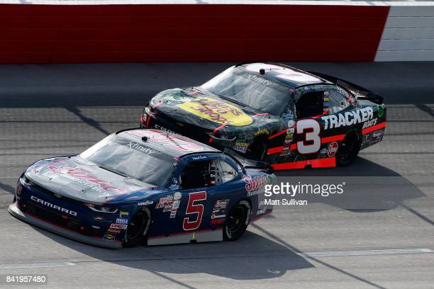 Michael Annett driver of the TMC Transportation Chevrolet leads Ty Dillon driver of the Bass Pro Shops/Tracker Boats Chevrolet during the NASCAR...