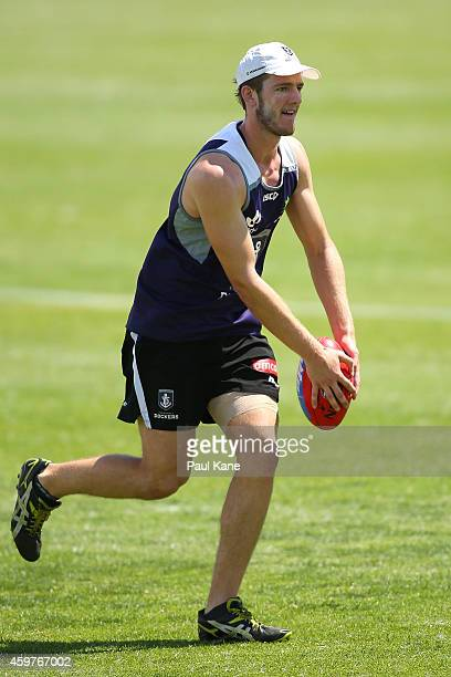 Michael Apeness of the Dockers looks to pass the ball during a Fremantle Dockers AFL preseason training session at Fremantle Oval on December 1 2014...