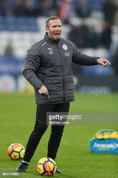 Michael Appleton Leicester City assistant manager gives his team instructions as they warm up prior to the Premier League match between Leicester...