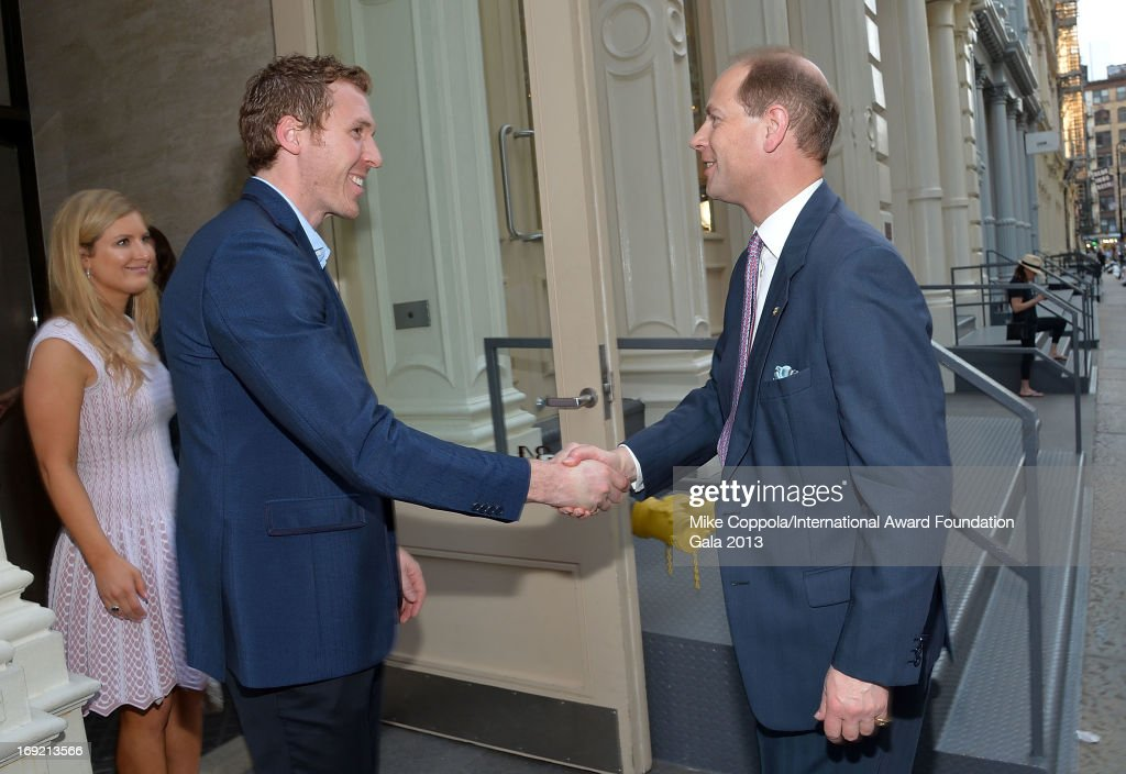 Michael Armilio (2nd from L) shakes the hand of HRH Prince Edward, Earl of Wessex before attending the The Duke of Edinburgh's International Award Foundation's Young Fellowship Dinner at a private residence in Soho on May 21, 2013 in New York City.