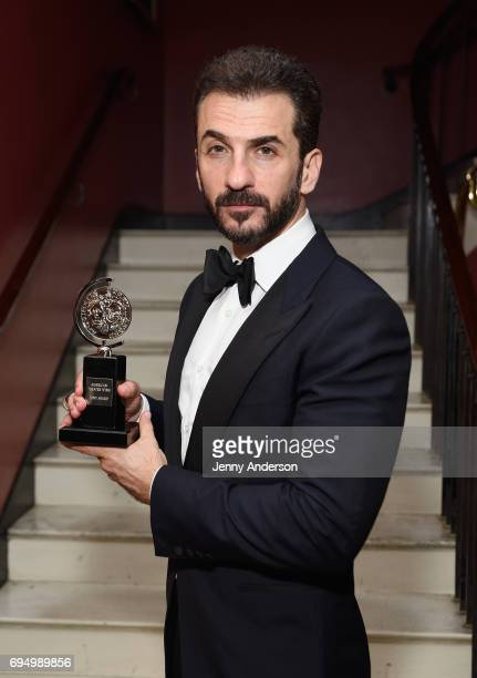 Michael Aronov winner of the award for Best Featured Actor in a Play for 'Oslo' poses in the press room during the 2017 Tony Awards at 3 West Club on...