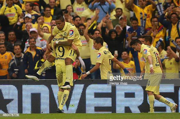 Michael Arroyo of America celebrates with teammates after scoring the first goal of his team during a Final second leg match between America and...