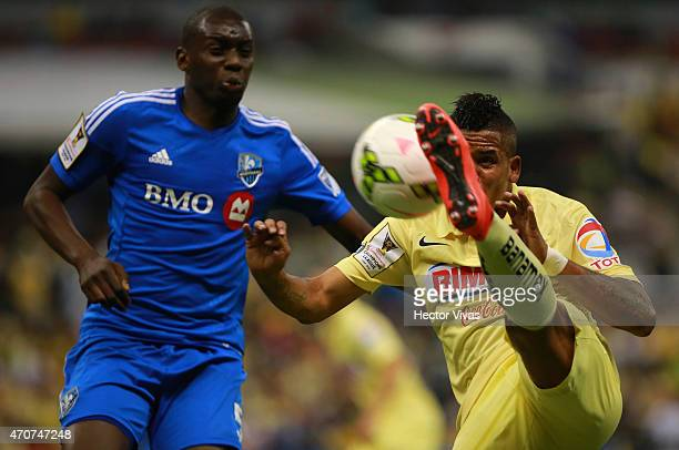 Michael Arroyo of America struggles for the ball with Bakary Soumare of Montreal Impact during a Championship first leg match between America and...