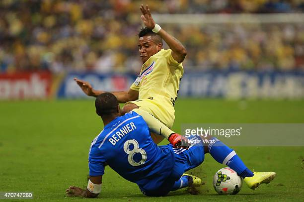 Michael Arroyo of America struggles for the ball with Patrice Bernier of Montreal Impact during a Championship first leg match between America and...
