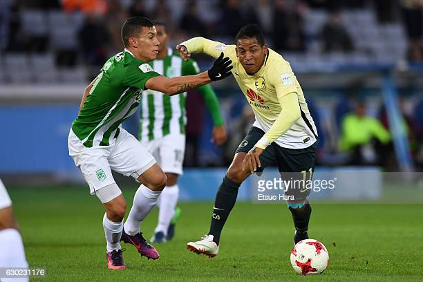 Michael Arroyo of Club America and Mateus Uribe of Atletico Nacional compete for the ball during the FIFA Club World Cup 3rd place match between Club...