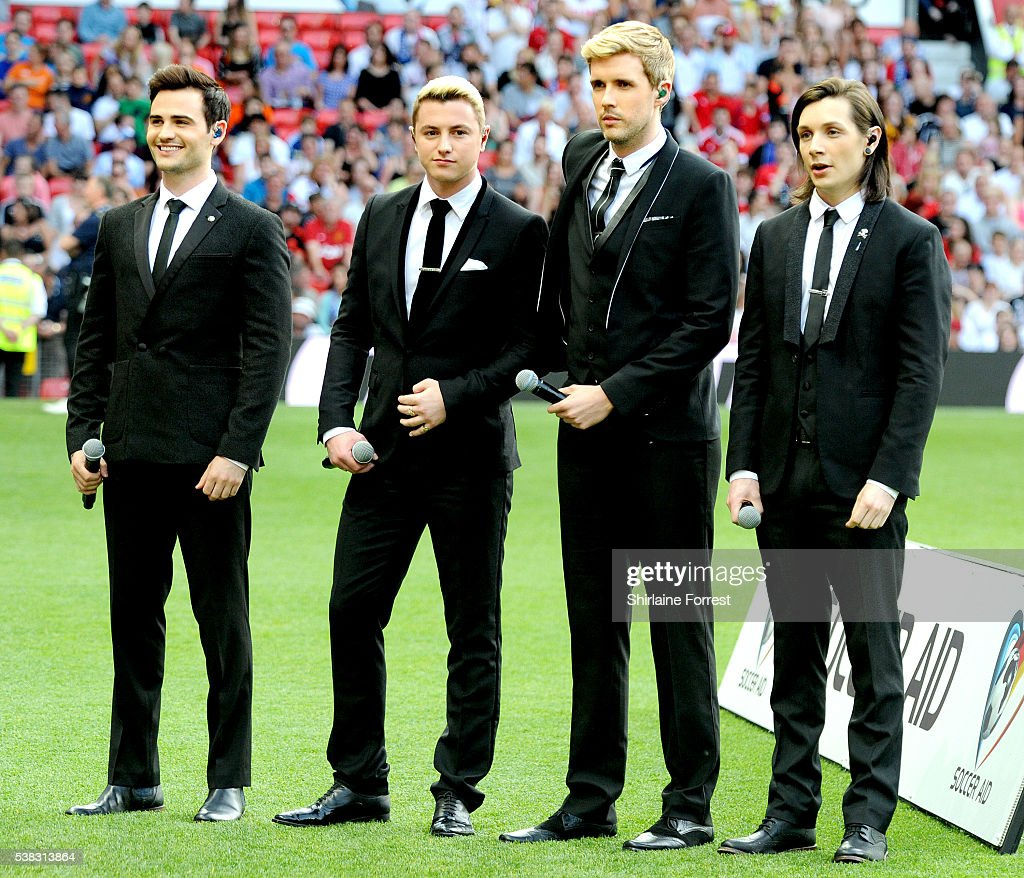 Michael Auger, Jamie Lambert, Matt Pagan and Thomas J Redgrave of Collabro perform for the first time as a four piece during Soccer Aid at Old Trafford on June 5, 2016 in Manchester, England.