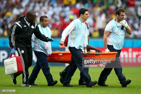 Michael Babatunde of Nigeria is taken off by a stretcher as he picks up injury during the 2014 FIFA World Cup Brazil Group F match between Nigeria...
