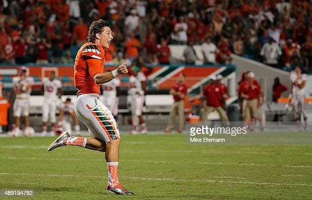 Michael Badgley of the Miami Hurricanes celebrates the winning field goal during a game against the Nebraska Cornhuskers at Sun Life Stadium on...