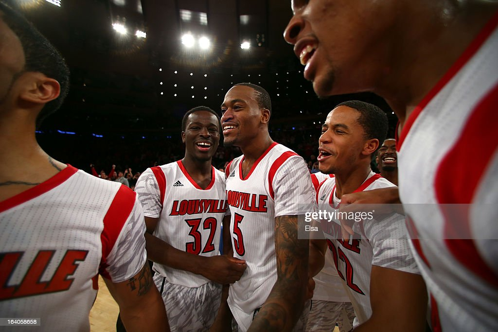Michael Baffour #32, Kevin Ware #5 and Jordan Bond #22 of the Louisville Cardinals celebrate after they won 78-61 against the Syracuse Orange during the final of the Big East Men's Basketball Tournament at Madison Square Garden on March 16, 2013 in New York City.