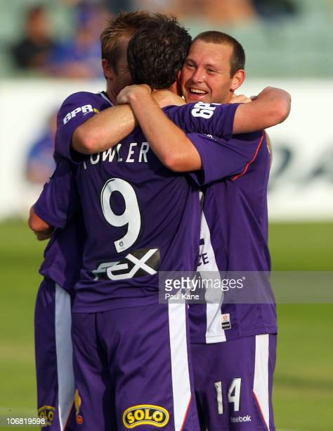 Michael Baird and Steve McGarry of the Glory congratulate Robbie Fowler after scoring his third goal during the round 14 ALeague match between the...