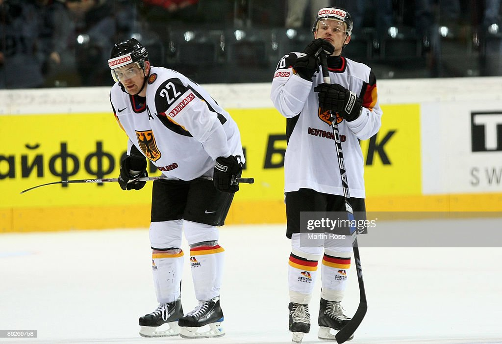 Michael Bakos and Michael Wolf of Germany looks dejected after the IIHF World Ice Hockey Championship preliminary round group B match between France...