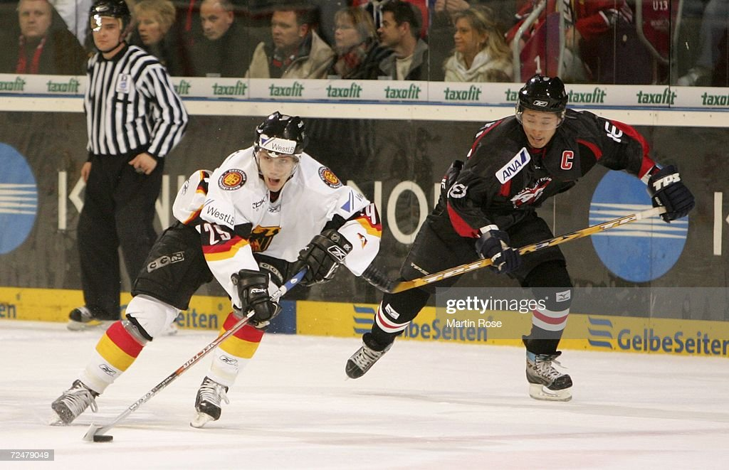 Michael Bakos of Germany and Takahito Suzuki of Japan compete for the puck during the EnBW German Nations Cup match between Germany and Japan at the...