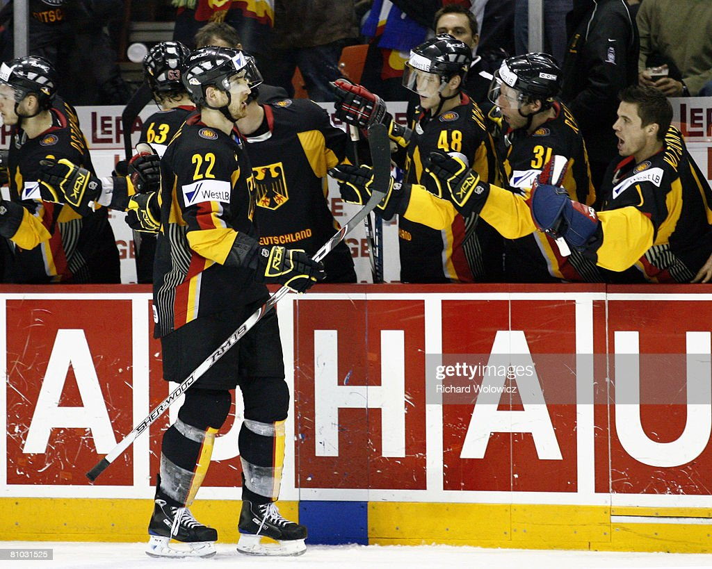 Michael Bakos of Germany celebrates his third period goal with team mates during the game against the United States at the IIHF World Ice Hockey...
