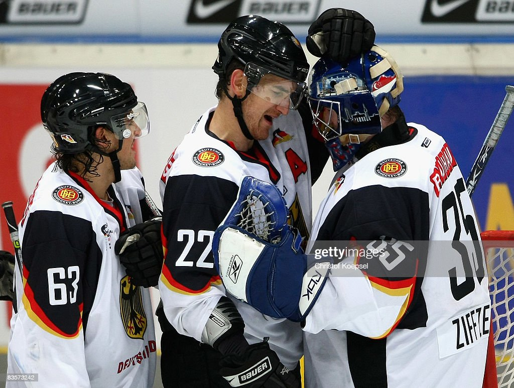 Michael Bakos of Germany embraces goalie Youri Ziffzer after winning 30 the International Friendly match between Germany and Canada at the Lanxess...