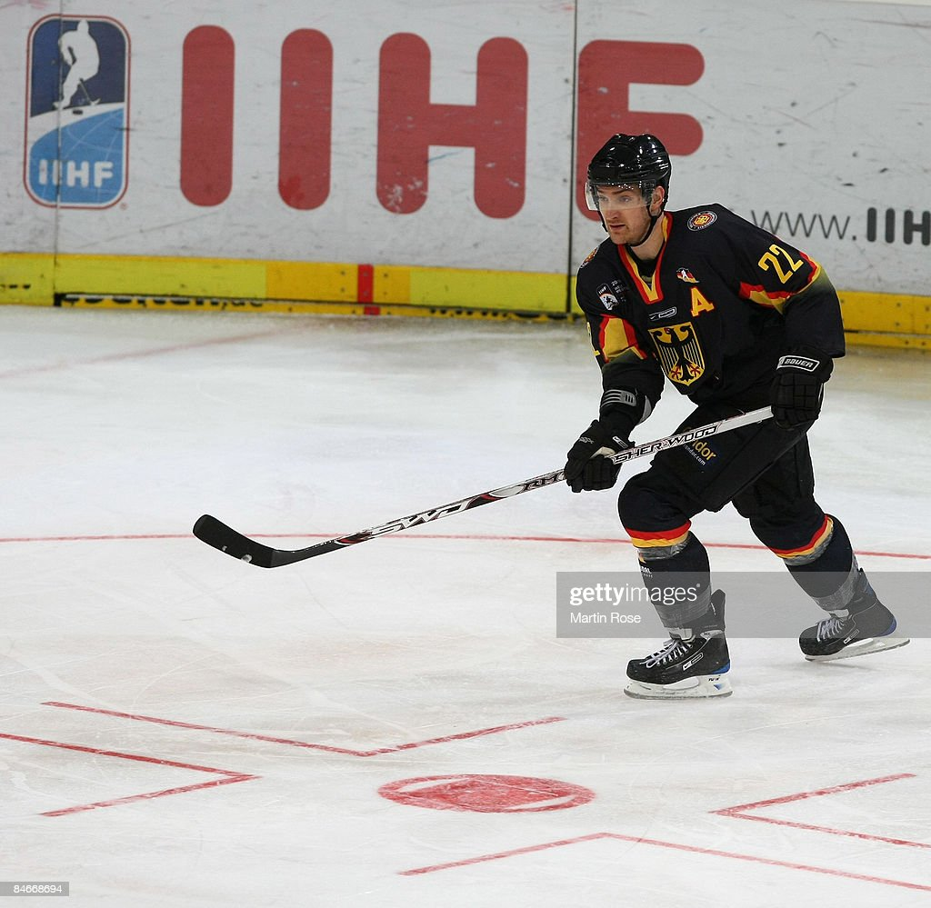 Michael Bakos of Germany runs with the puck during the Vancouver 2010 Qualifier match between Germany and Japan at the TUI Arena on February 5 2009...