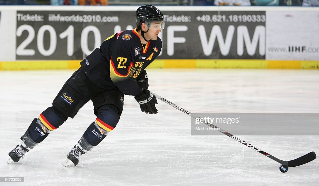 Michael Bakos of Germany runs with the puck during the Vancouver 2010 Qualifier match between Germany and Slovenia at the TUI Arena on February 8...