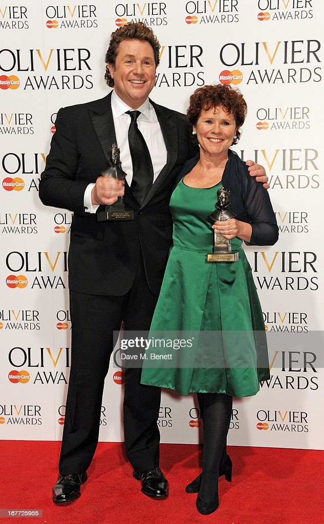 Michael Ball (L) and Imelda Staunton, winners of Best Actor and Actress in a Musical for 'Sweeney Todd', pose in the press room at The Laurence Olivier Awards 2013 at The Royal Opera House on April 28, 2013 in London, England.