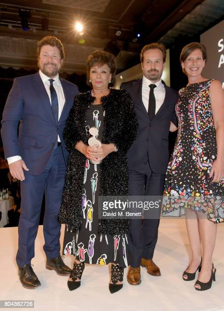 Michael Ball Dame Shirley Bassey Alfie Boe and Nina Bibby on stage with the O2 Silver Clef Award presented to Dame Shirley at the Nordoff Robbins O2...