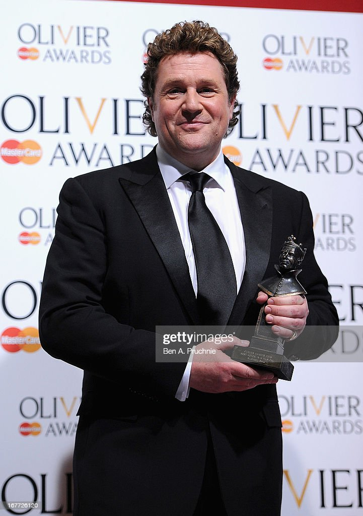 Michael Ball with his Best Actor in a Musical award during The Laurence Olivier Awards at the Royal Opera House on April 28, 2013 in London, England.