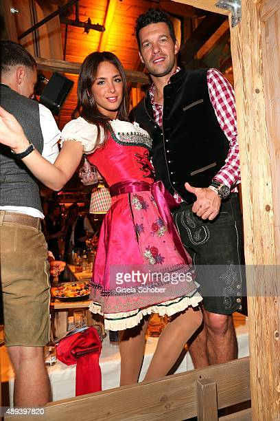 Michael Ballack and his girlfriend Natacha Tannous attend the Almauftrieb during the Oktoberfest 2015 at Kaeferschaenke beer tent on September 20...