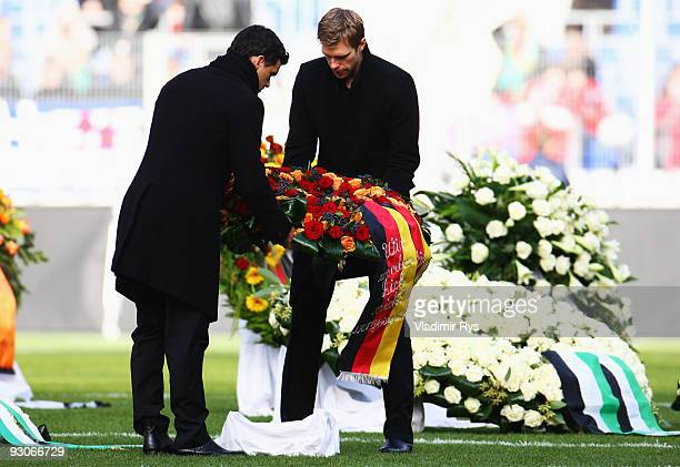 Michael Ballack and Per Mertesacker lay down a wreath at the coffin of their goalie Robert Enke at a memorial service prior to Enke�s funeral at AWD...