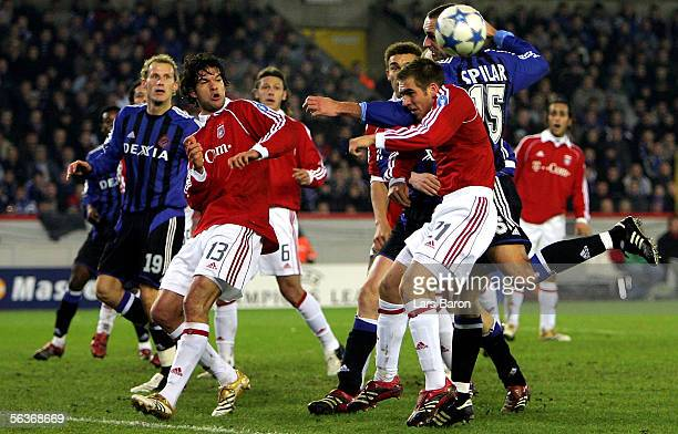 Michael Ballack and Philipp Lahm of Munich in action with Marek Spilar of Bruges during the Champions League Group A match between Club Bruges and...