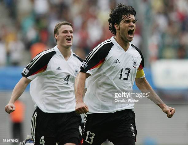 Michael Ballack and Robert Huth of Germany celebrate the fourth goal for Germany during the game between germany and Mexico for the third place of...