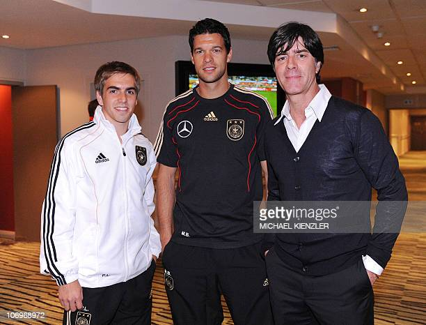 Michael Ballack former captain of the German national football team poses with Germany's head coach German Joachim Loew and defender Philipp Lahm at...