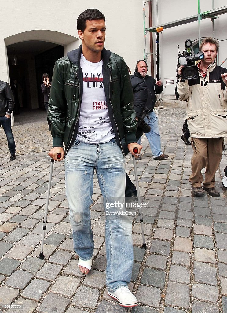 <a gi-track='captionPersonalityLinkClicked' href=/galleries/search?phrase=Michael+Ballack&family=editorial&specificpeople=202166 ng-click='$event.stopPropagation()'>Michael Ballack</a>, German National Football player, uses crutches leaving the practice of doctor Hans-Wilhelm Mueller-Wohlfahrt on May 17, 2010 in Munich, Germany. Ballack has been forced out of the World Cup finals due to an ankle injury which he picked up in the FA final last Saturday.
