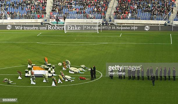 Michael Ballack German National Team captain and Per Mertesacker put down a wreath next to the coffin of Hannover 96 goalkeeper Robert Enke at a...