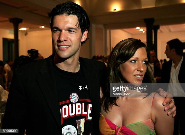 Michael Ballack of Bayern and his wife Simone celebrate winning the German Football Federations Cup Final between FC Schalke 04 and Bayern Munich on...