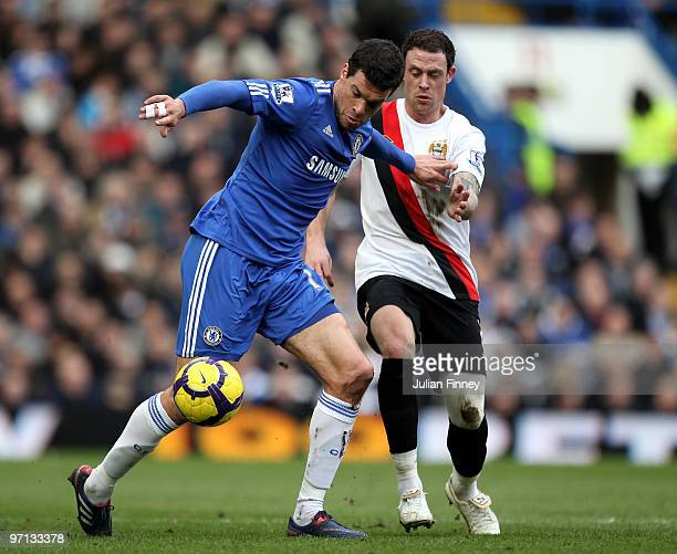Michael Ballack of Chelsea and Wayne Bridge of Manchester City in action during the Barclays Premier League match between Chelsea and Manchester City...